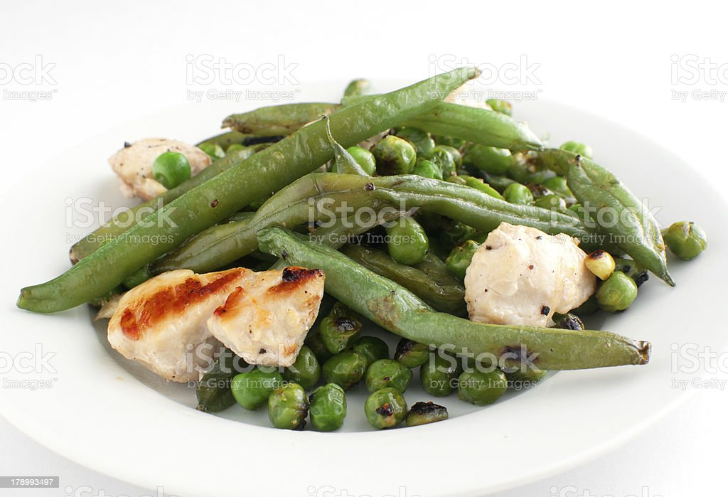 Stir fry chicken with green peas and beans stock photo