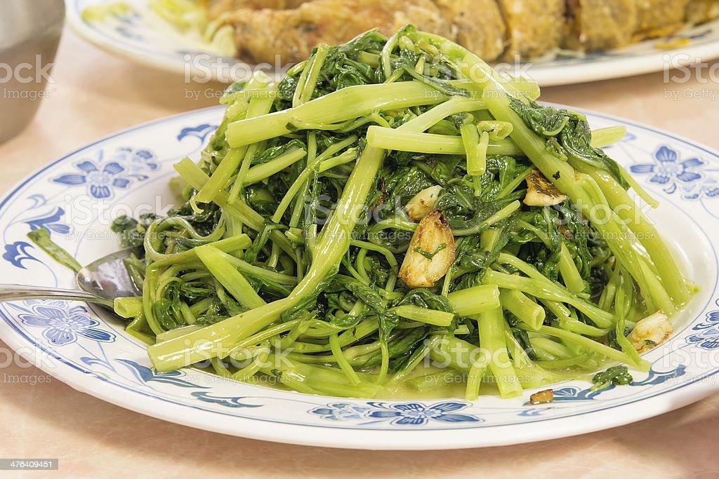 Stir Fry Chinese Kangkong Vegetable Closeup royalty-free stock photo