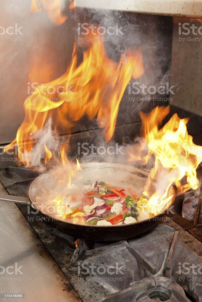 Stir Fry Cooking in Flaming Pan stock photo