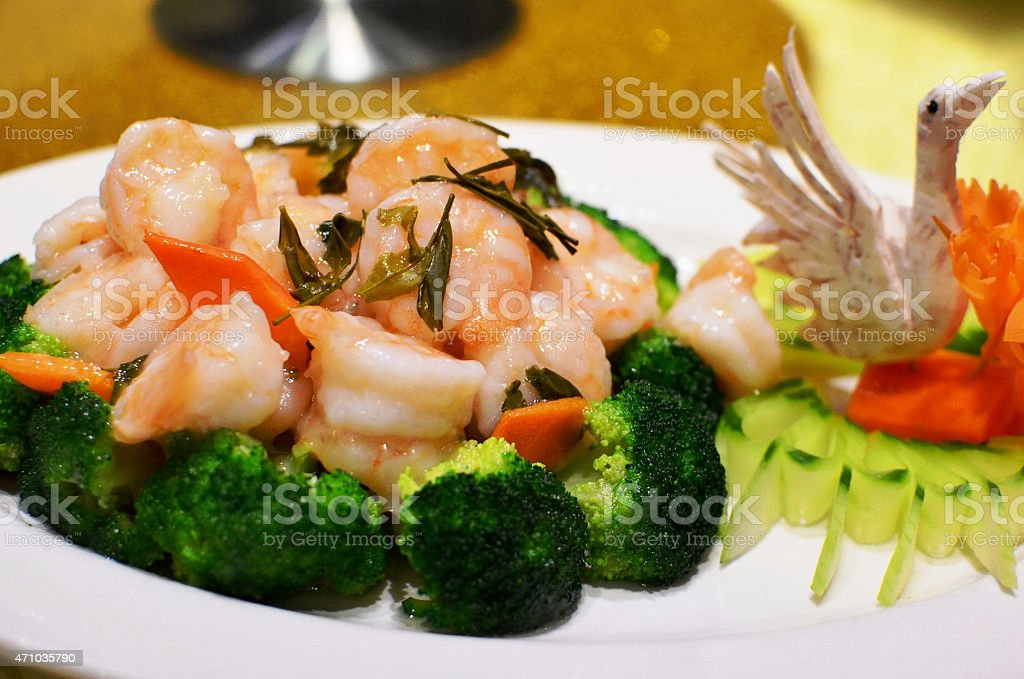 Stir fry shrimps with tea leaves stock photo