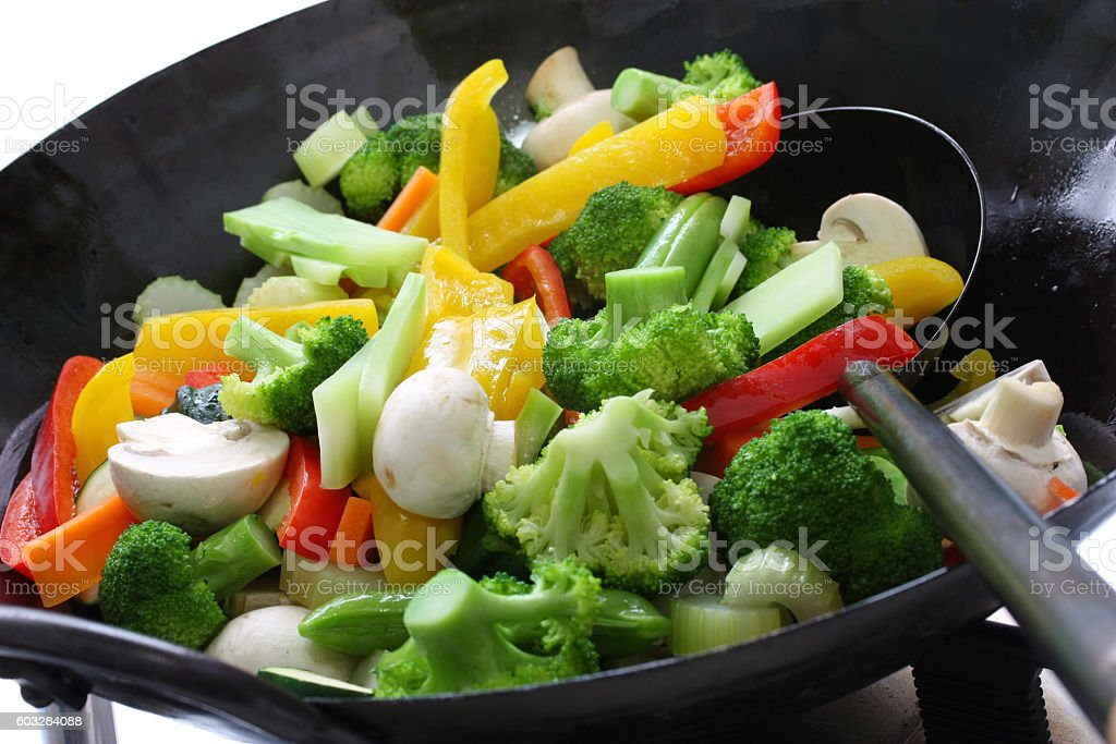 stir fry vegetables in a chinese wok stock photo