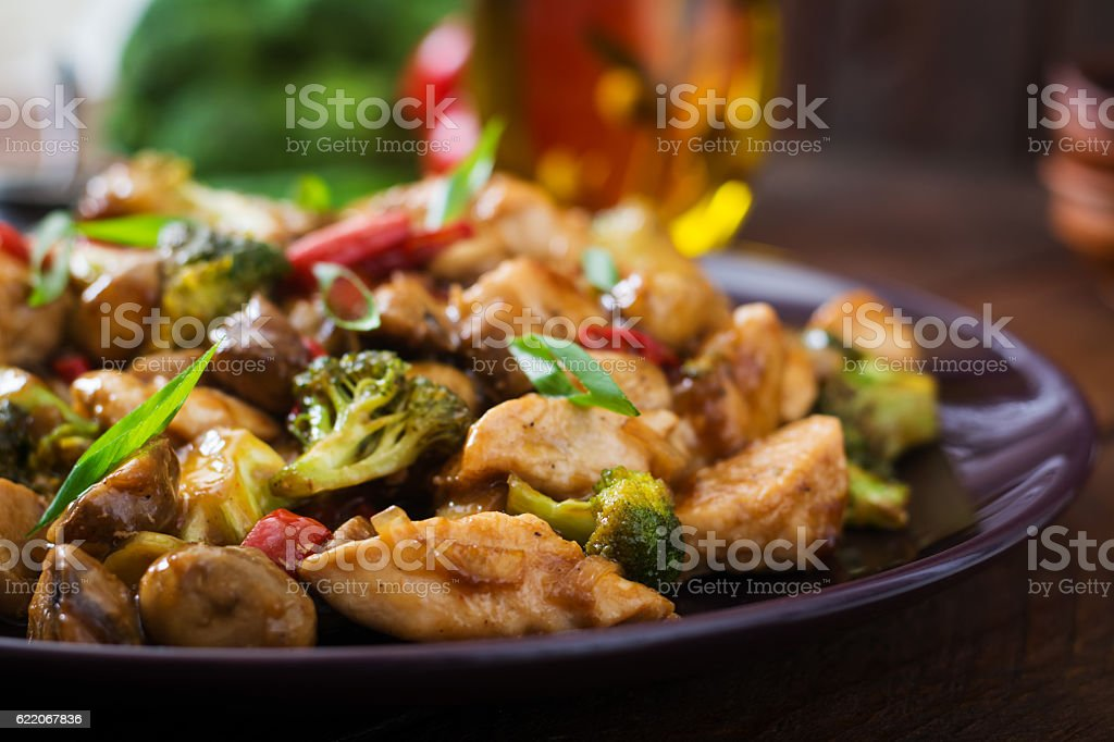 Stir fry with chicken, mushrooms, broccoli and peppers stock photo