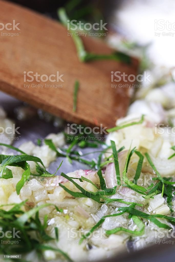Stir frying onion royalty-free stock photo