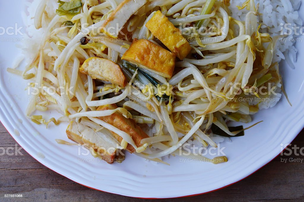 stir-fried bean sprout with yellow tofu on rice stock photo