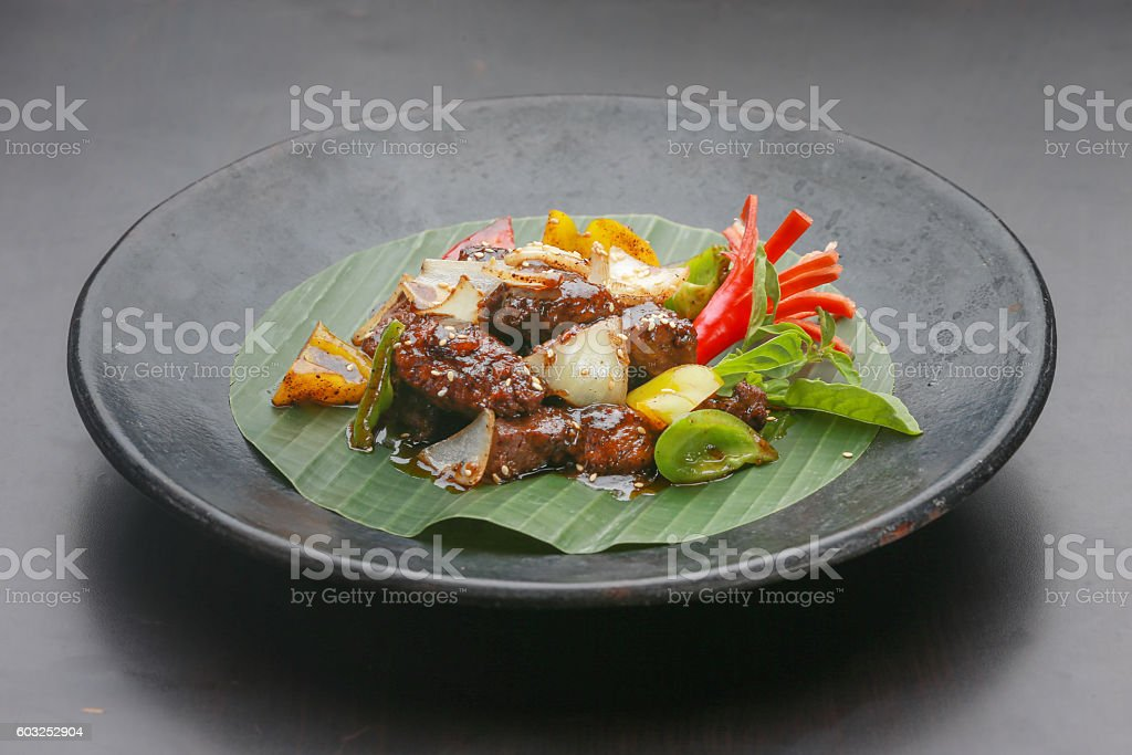 Stir-fried beef with vegetable and sesame seeds stock photo