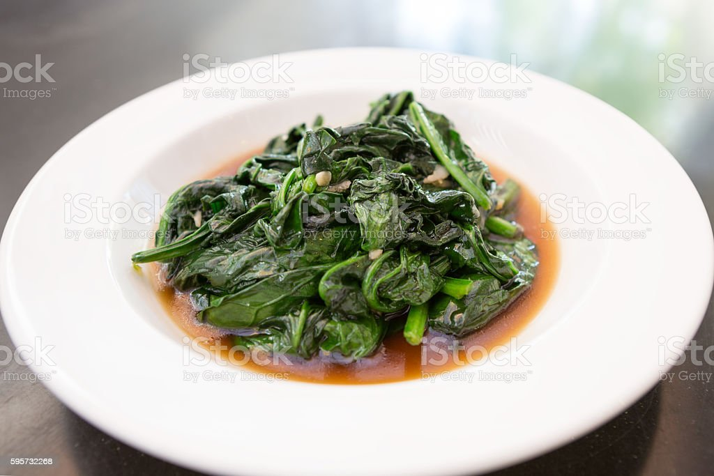 stir-fried chines cabbage with oyster sauce stock photo