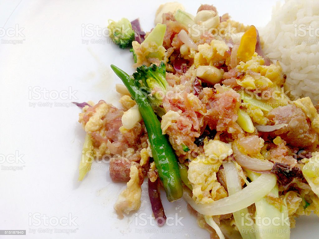 Stir-fried egg with Sour sausage in banana leaf, pork stock photo