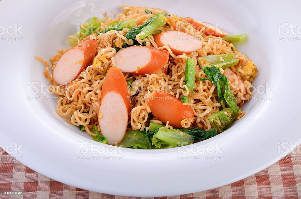 stir-fried instant noodle with chicken sausage stock photo