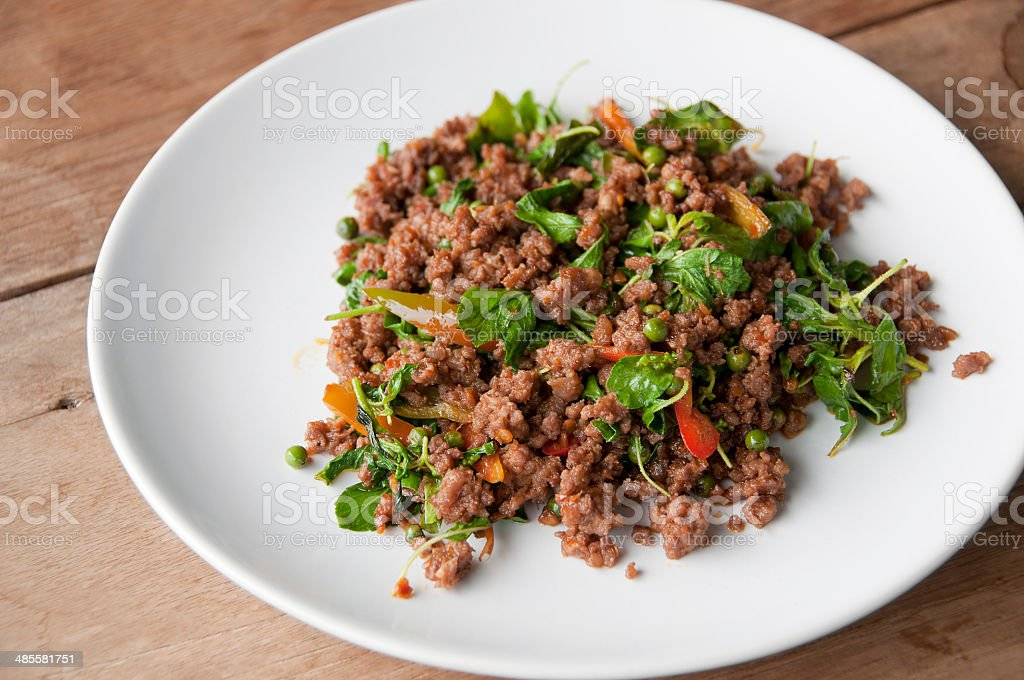 Stir-fried minced beef with basil and chili. stock photo
