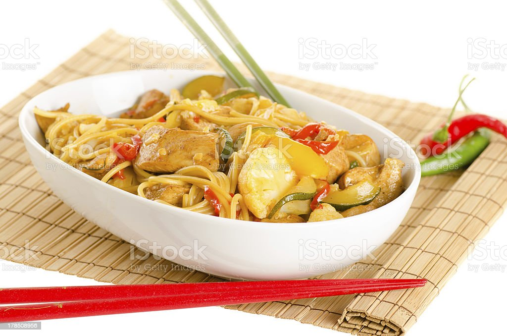 Stir-fried noodles with chicken and vegetables royalty-free stock photo
