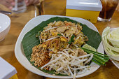 Stir-fried rice noodles pad thai on banana leaves
