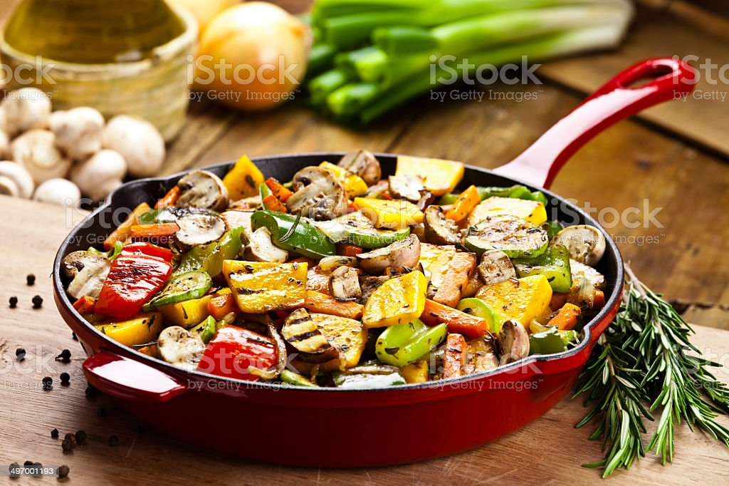 Stir-fried vegetables in an iron pan stock photo