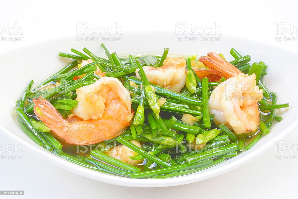 stir-fry flowering chinese chives with prawns stock photo
