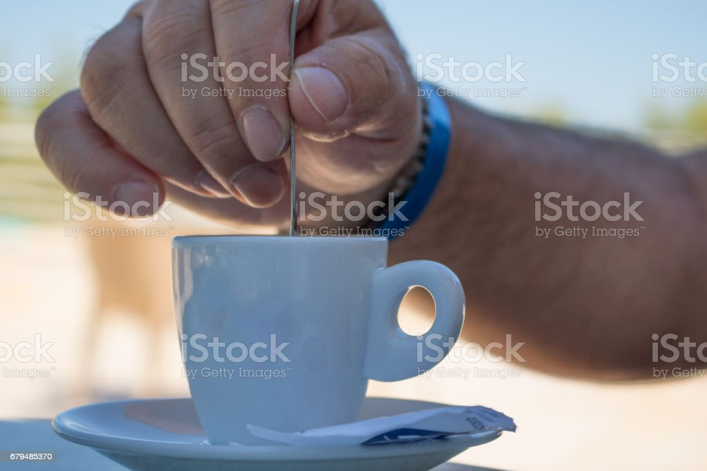 Stiring coffee stock photo