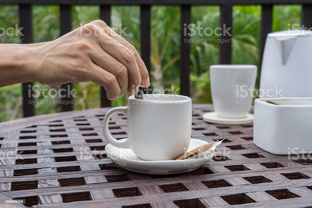 Stirring in coffee cup stock photo