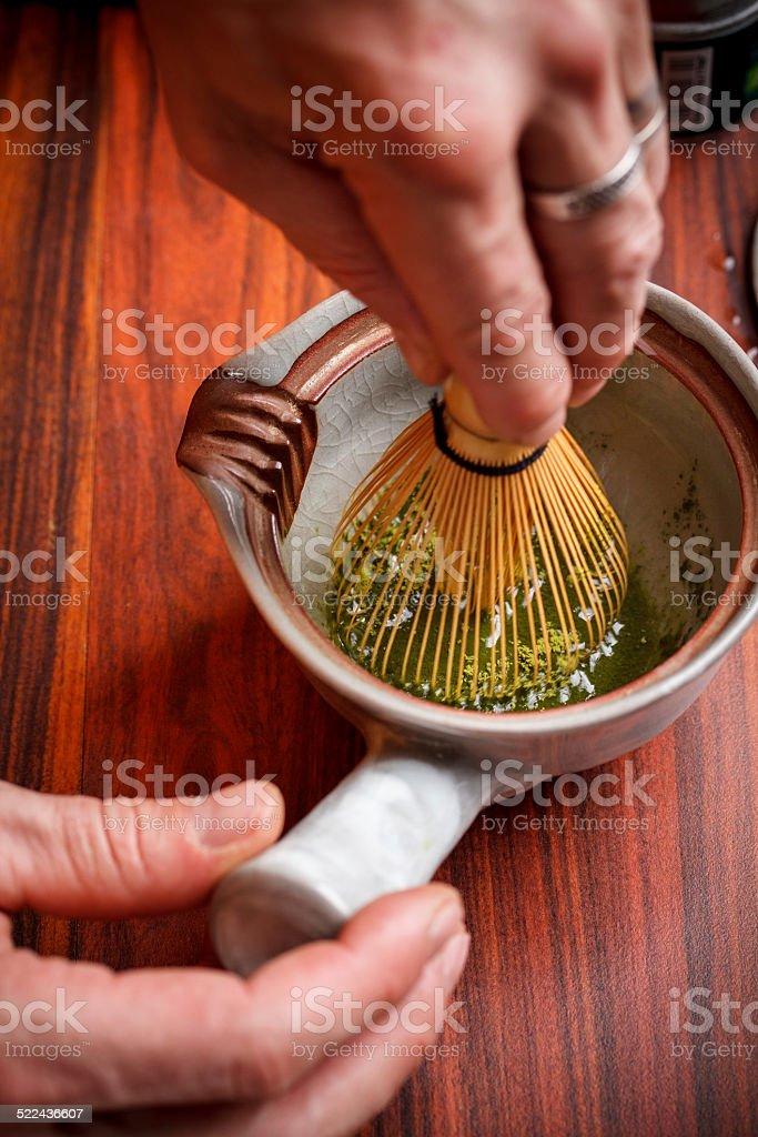 Stirring matcha tea stock photo