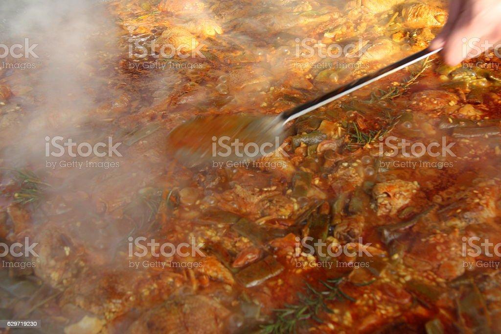 Stirring the Paella stock photo