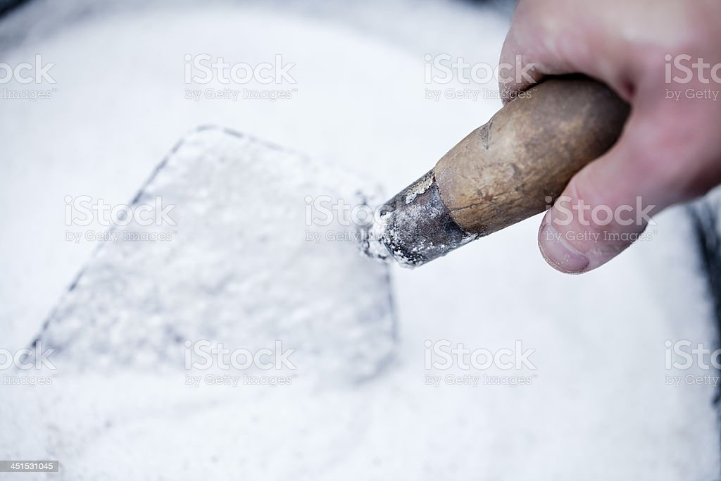 Stirring up a cement mixture royalty-free stock photo