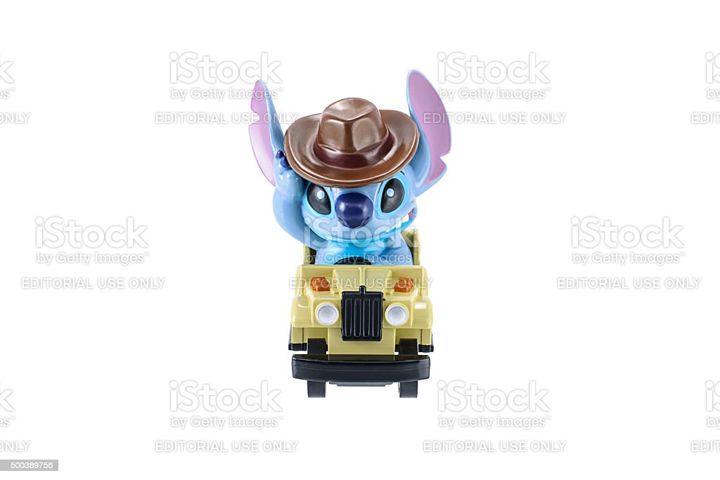 Stitch plastic toy character ride a jeep car. stock photo