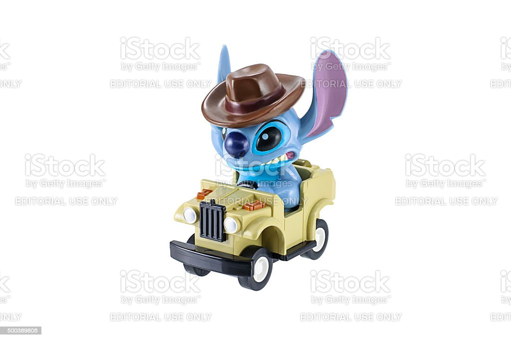 Stitch plastic toy charector ride a jeep car. stock photo
