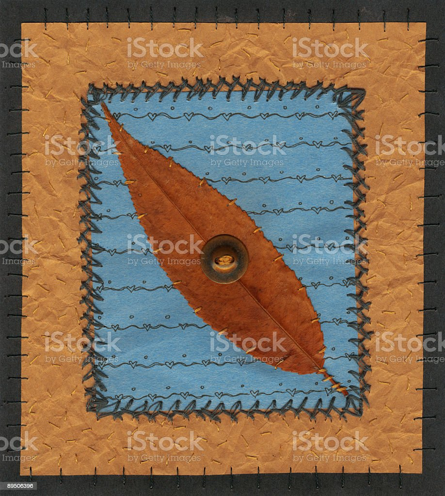 Stitched paper and leaf royalty-free stock photo