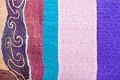 stitched pieces of clenched silk fabrics and batik