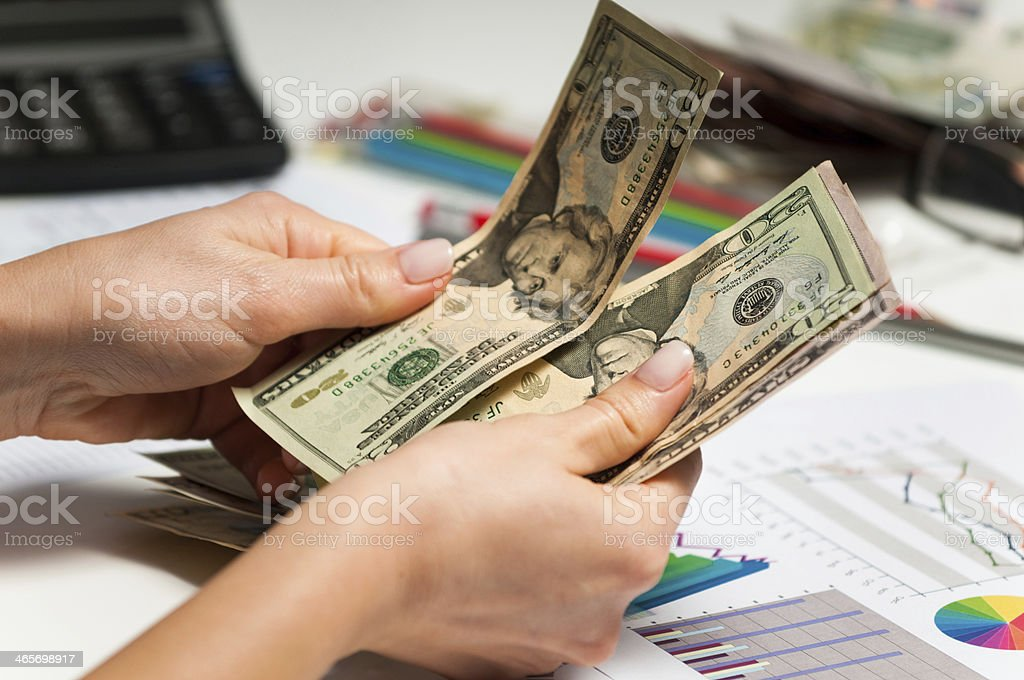 Stock broker counting profit after trading with growing markets shares stock photo