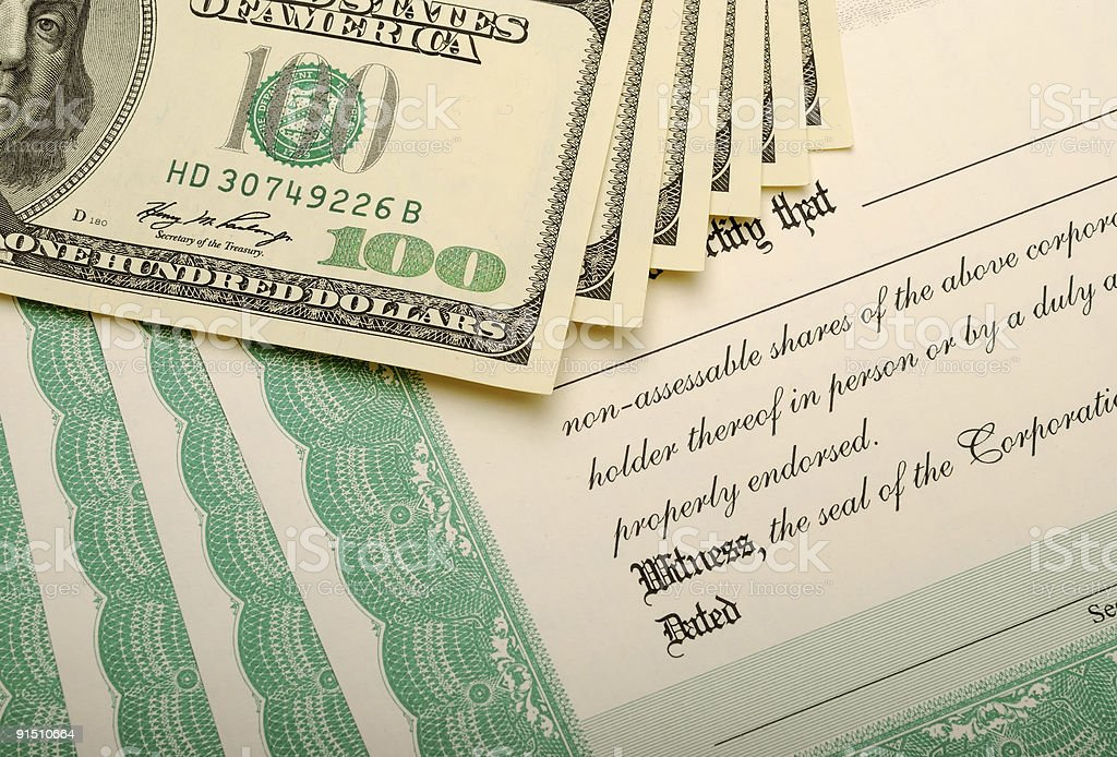 Stock Certificates and Dollar Bills royalty-free stock photo