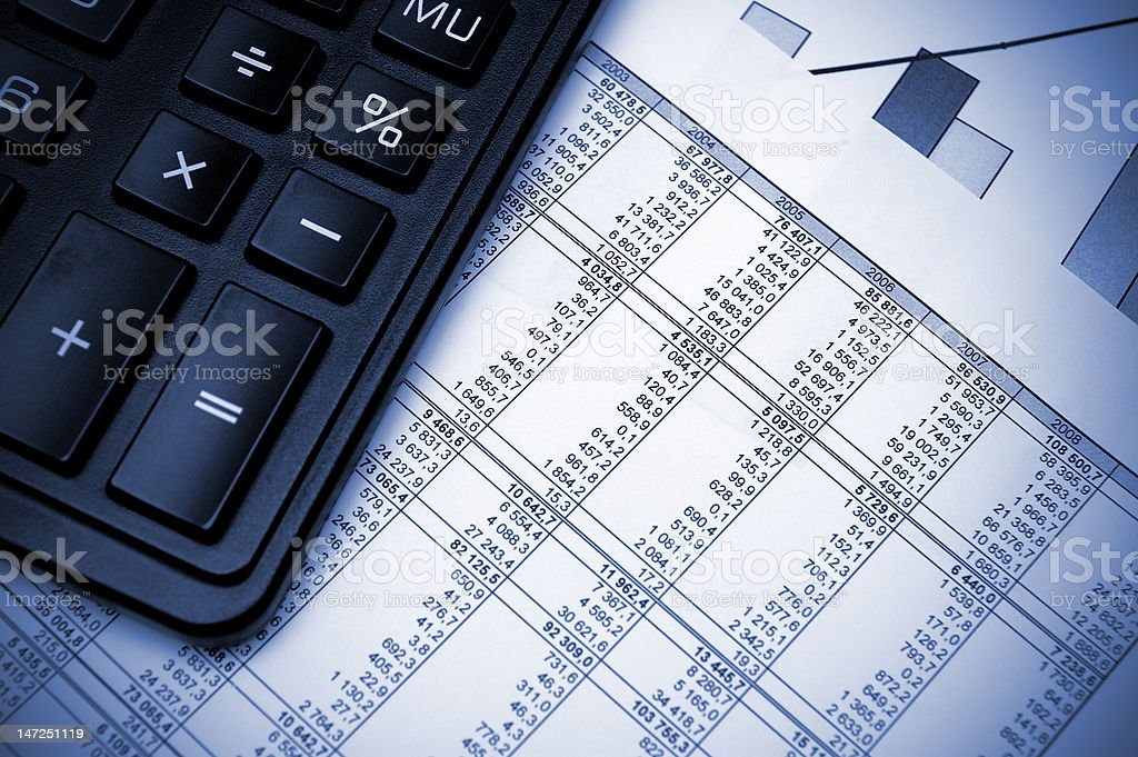 Stock chart and calculator. Blue toned. royalty-free stock photo