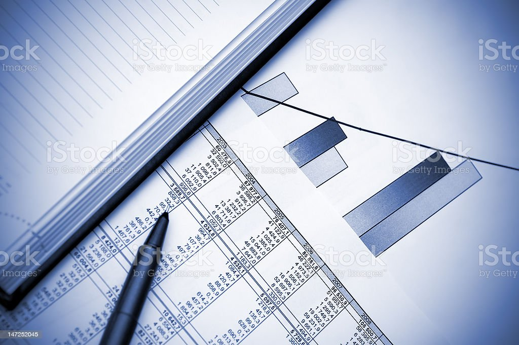 Stock chart, pen and notebook. Blue toned. royalty-free stock photo