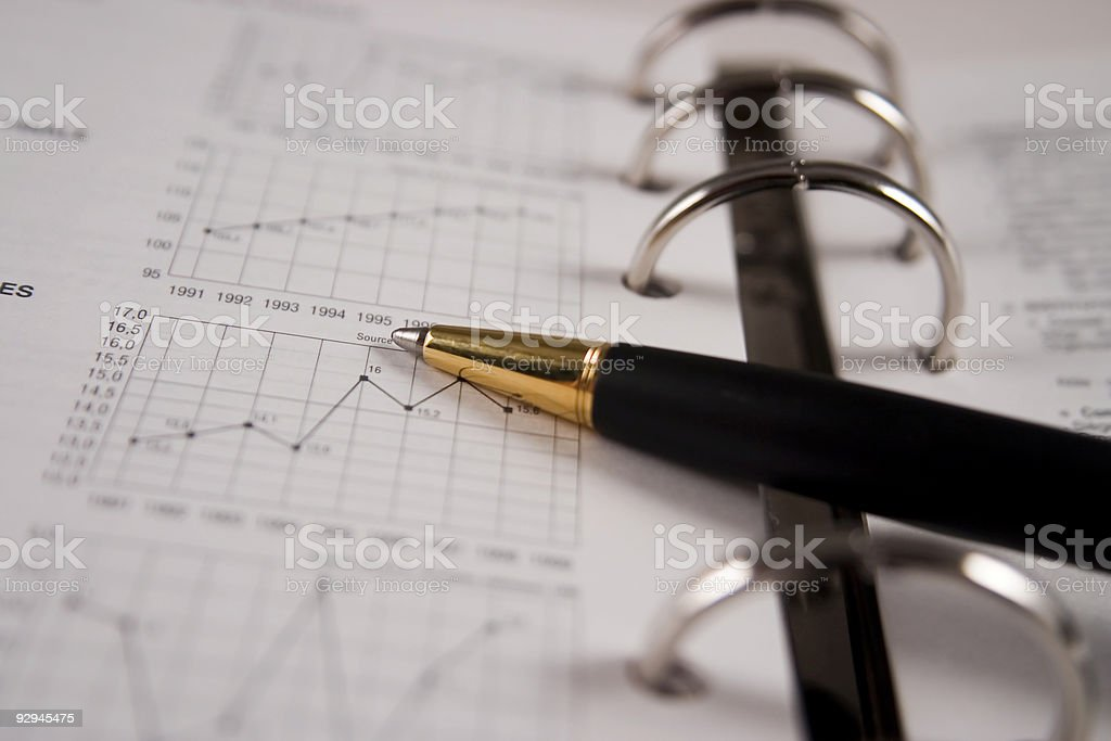Stock chart with a pen royalty-free stock photo