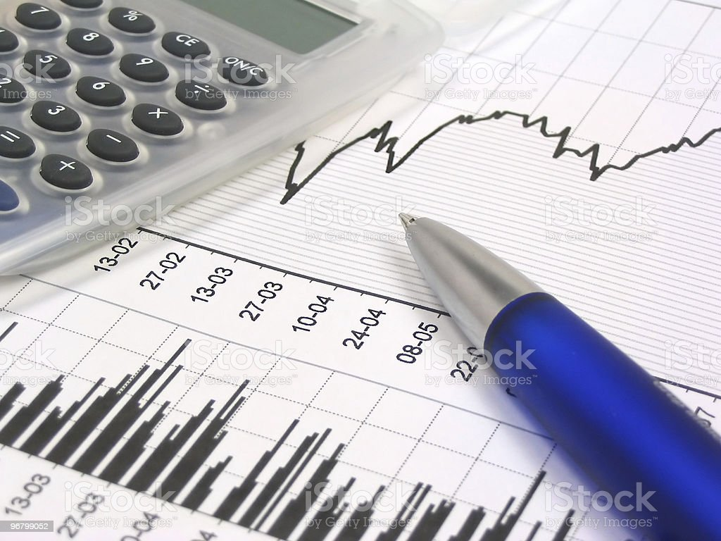 Stock chart with calculator and pen royalty-free stock photo
