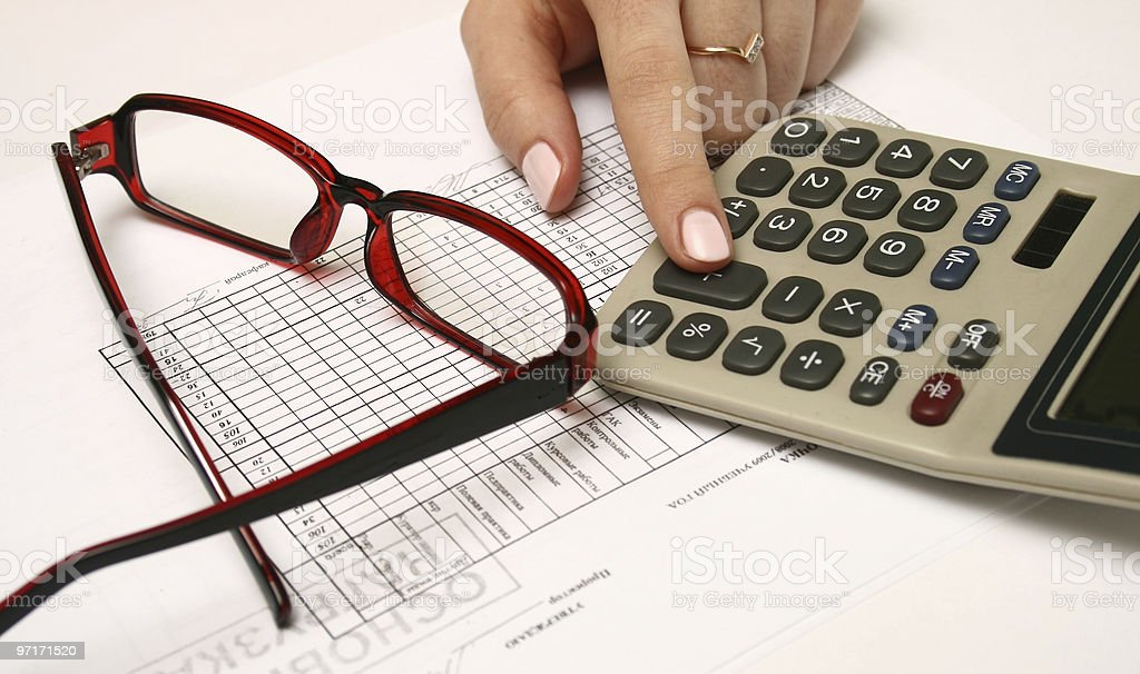 Stock chart with calculator royalty-free stock photo