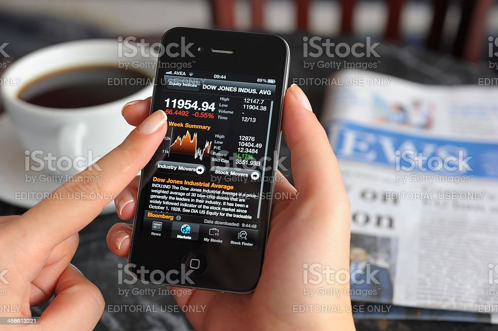 Stock charts on iPhone 4 stock photo