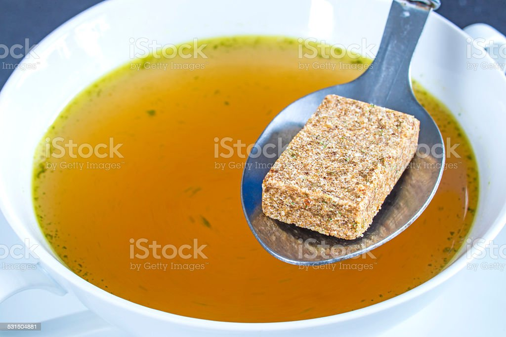 Stock cube with broth stock photo