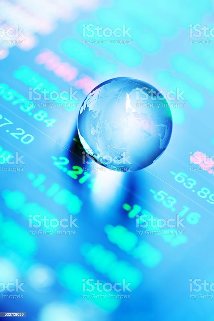 stock data green in phone screen with global crystal ball stock photo