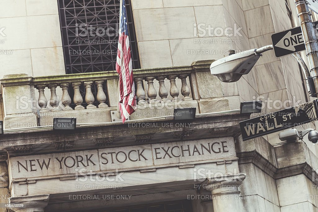 Stock Exchange in Wall Street and American Flag, Manhattan royalty-free stock photo