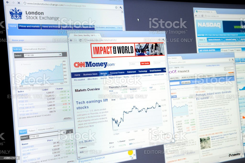 Stock Exchange websites on computer monitor stock photo