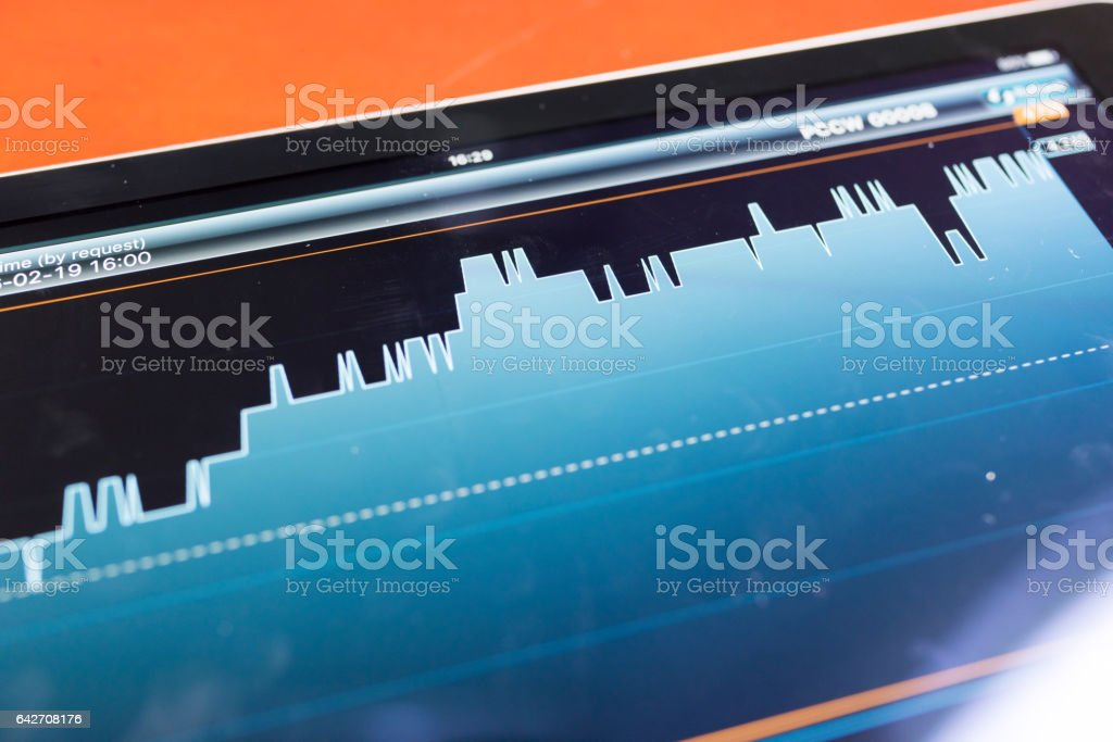 Stock graph with tablet stock photo
