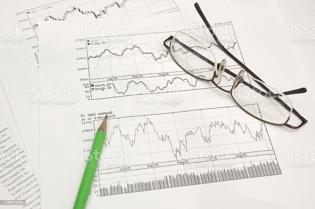 stock graphs, pencil and glasses royalty-free stock photo