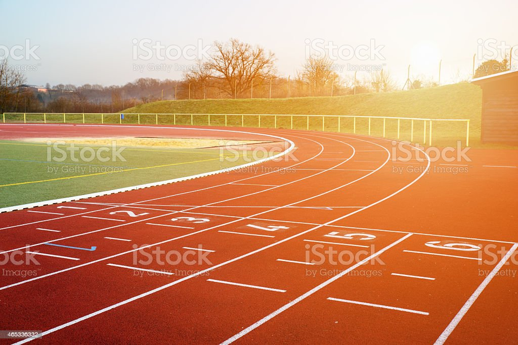 Stock image of a running track in the evening stock photo