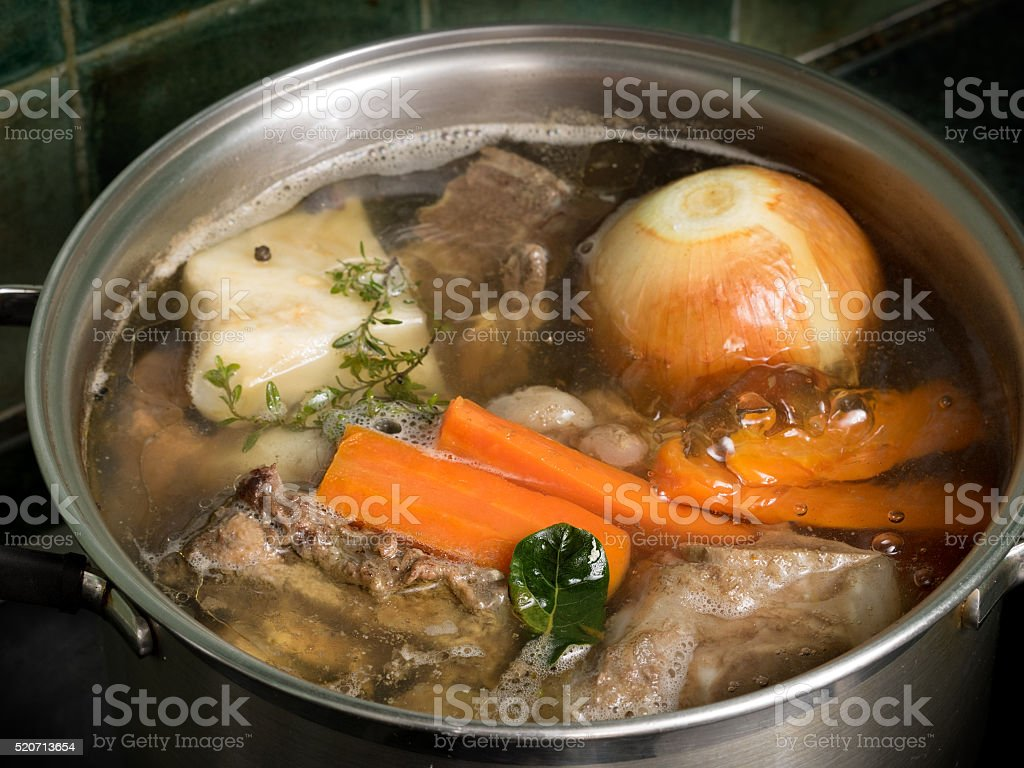Stock in a steel pot on the stove royalty-free stock photo