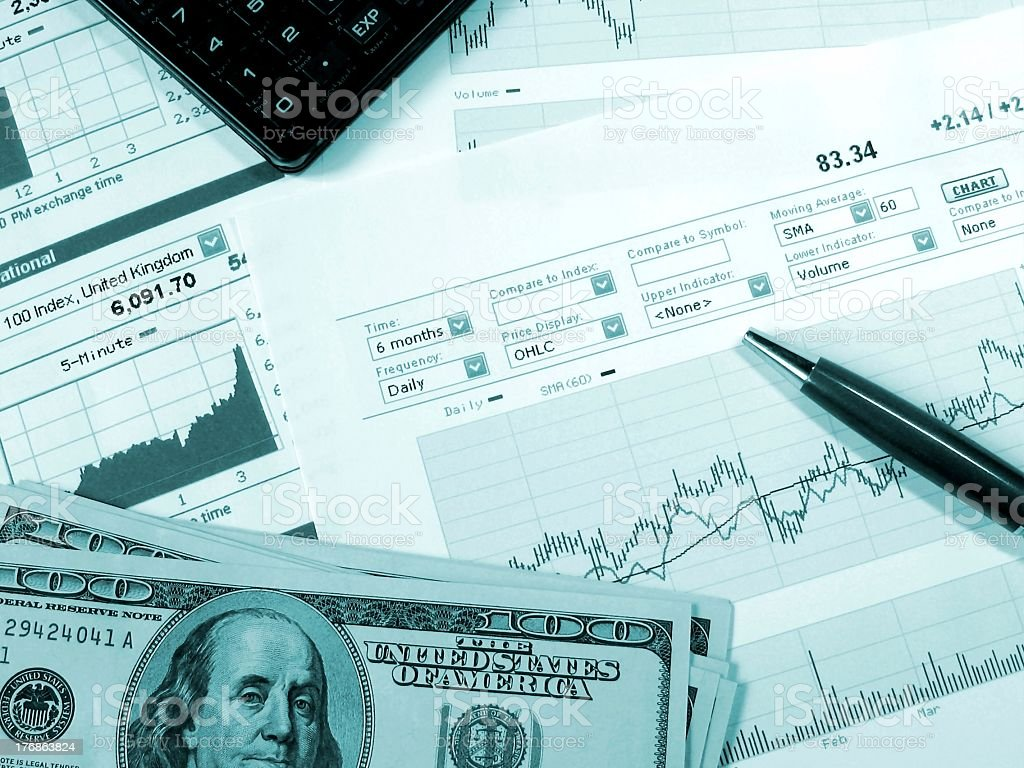 A stock market analysis with money notes stock photo