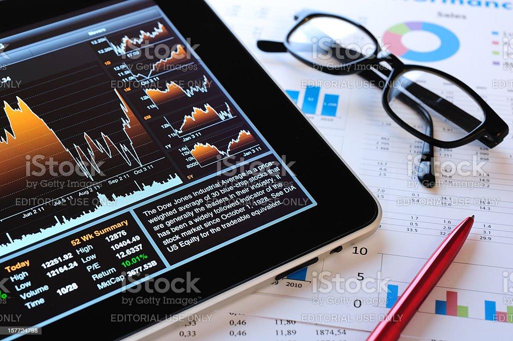 Stock Market analyze with iPad stock photo