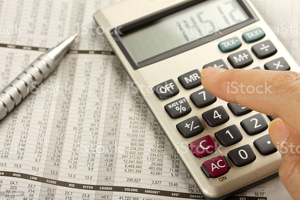 Stock market calculation with calculator stock photo