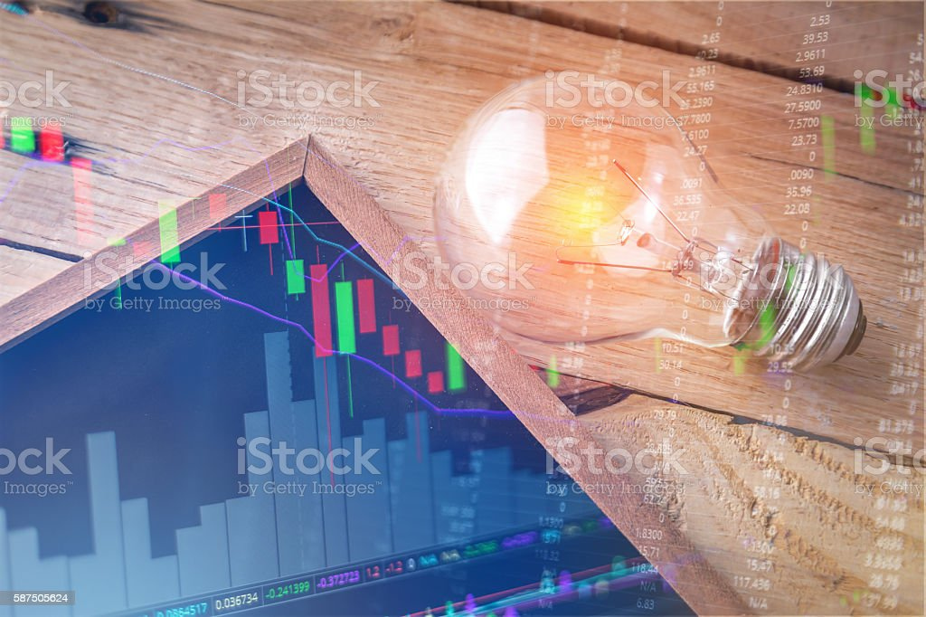 stock market chart with light bulb and free copy space stock photo