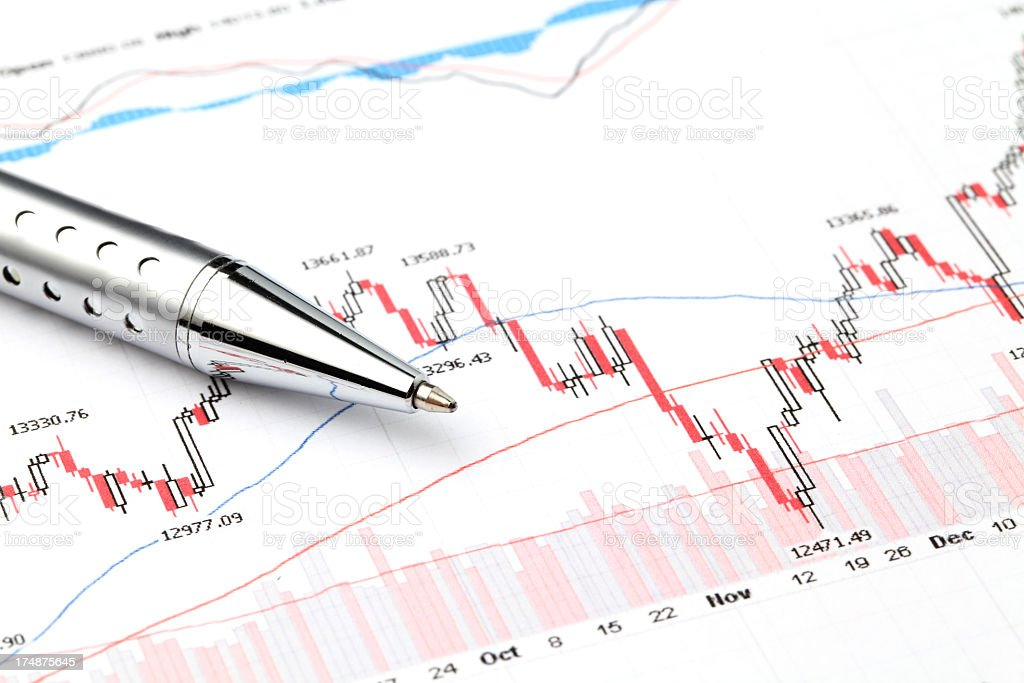 stock market chart with pen stock photo