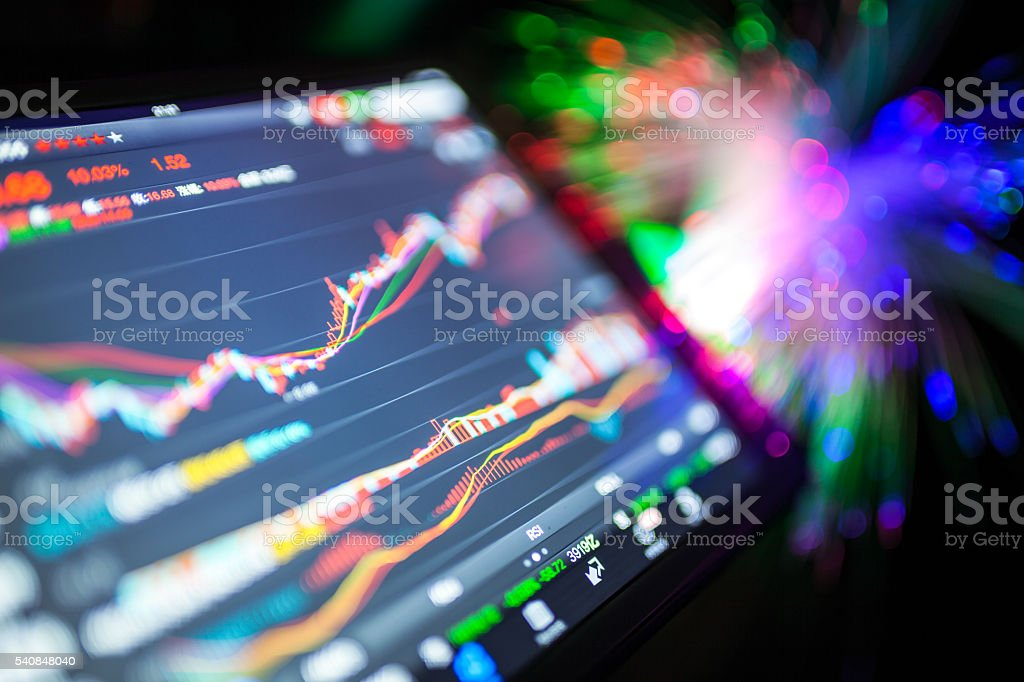 stock market data on tablet stock photo