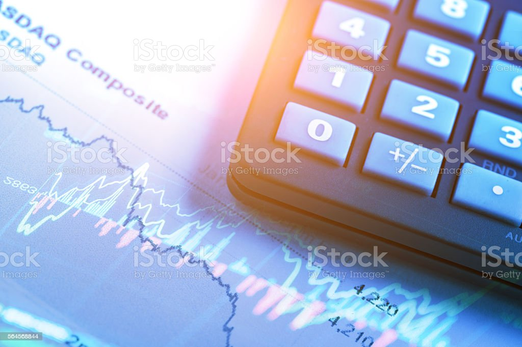 stock market data with calculator stock photo