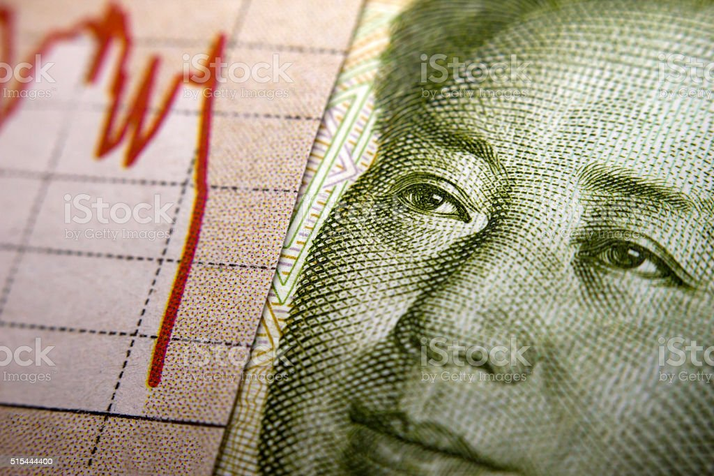 Stock Market Graph and Chinese banknote stock photo